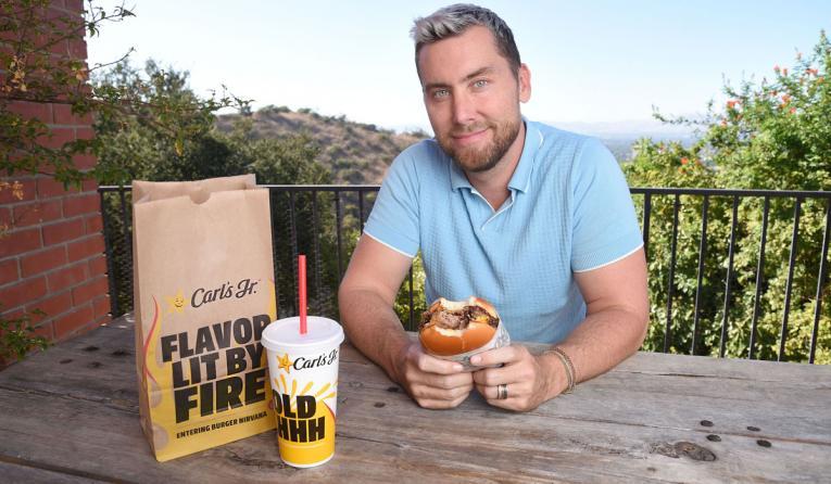 Lance Bass eating a Carl's Jr. burger.