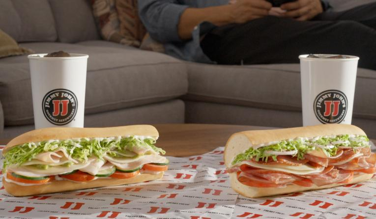 Jimmy John's sandwiches with drinks.