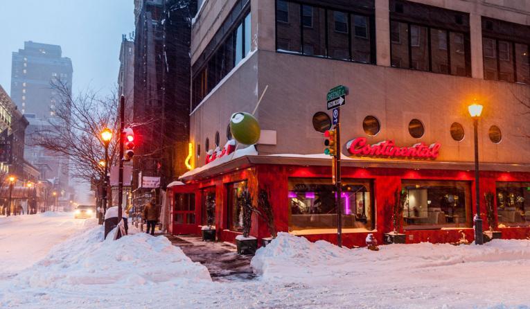 Snow outside a restaurant.
