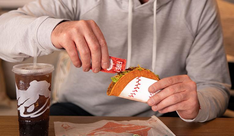 Taco Bell customer eats a Doritos Locos taco.