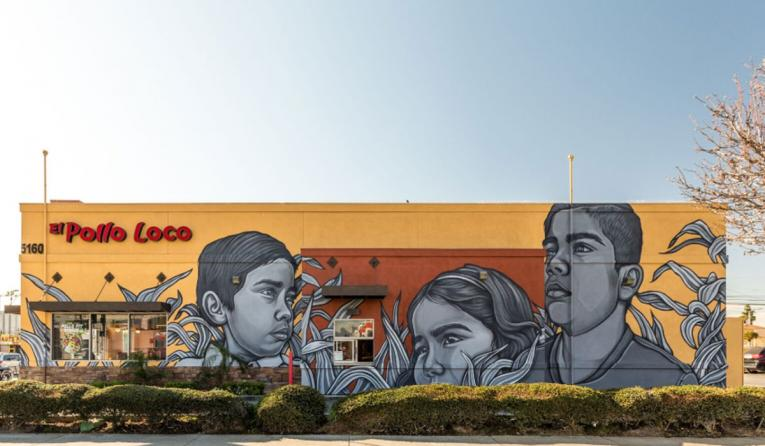 El Pollo Loco mural outside restaurant.