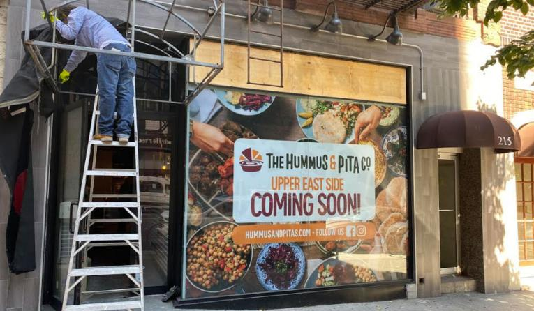 The Hummus & Pita Co. store being built.