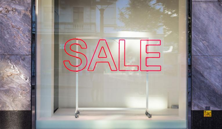 A sale sign in a window.