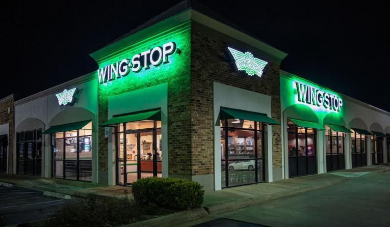 Wingstop exterior of restaurant at night.