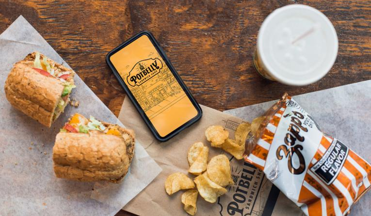 Potbelly food and phone with a Potbelly app open.
