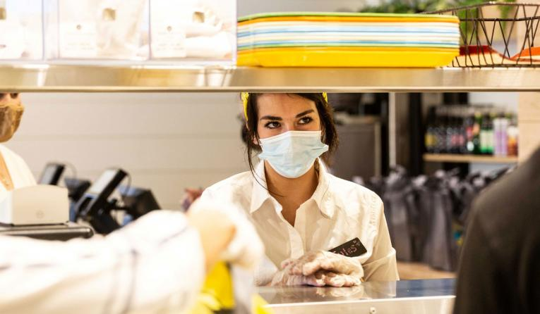 Modern Market employee with a mask.