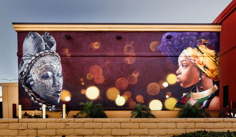 El Pollo Loco mural outside restaurant.