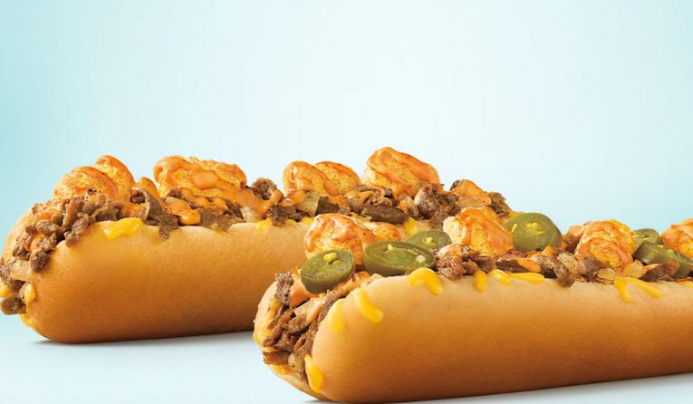 Extra-Long Ultimate Cheesesteaks, layered with Sonic's famous golden Tots.