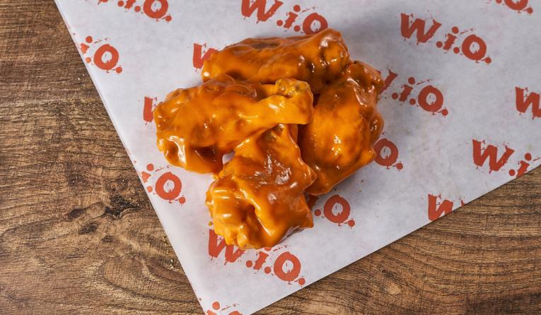 Wing It On! wings with sauce.