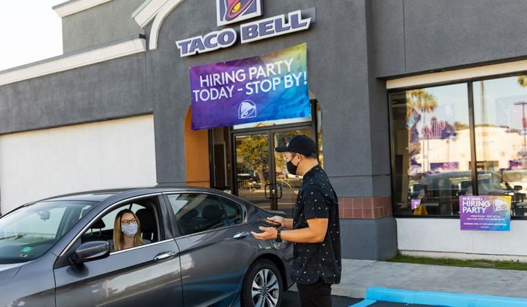 Taco Bell drive-thru employee interviewing a candidate.