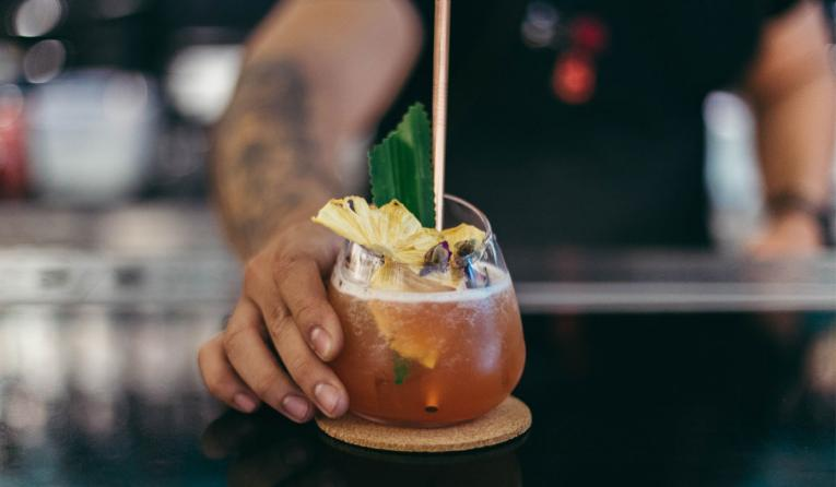 Cocktail being served by a restaurant.