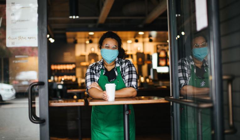 Starbucks employee at the window.
