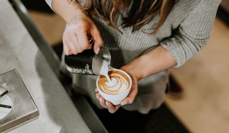 Barista making coffee.