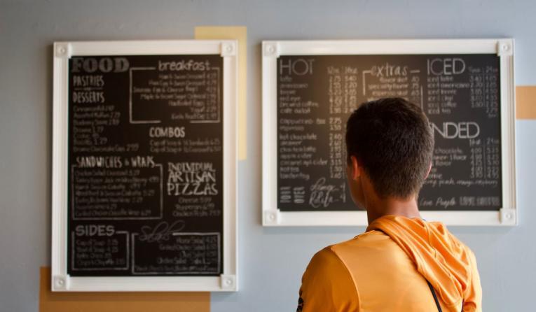 Customer looking at menu.