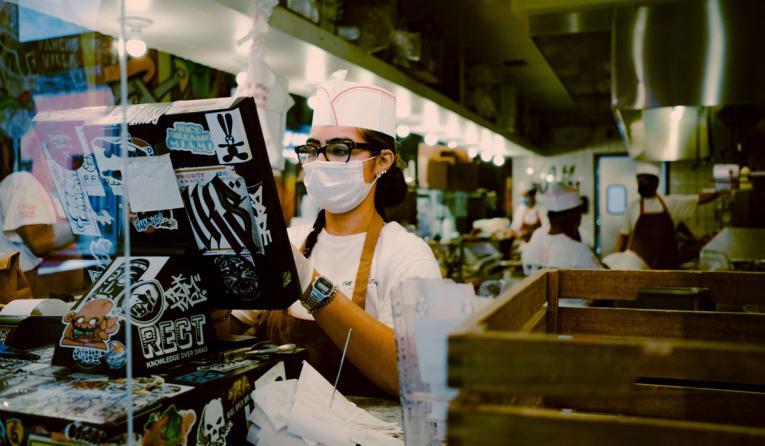 Restaurant employee at the register.