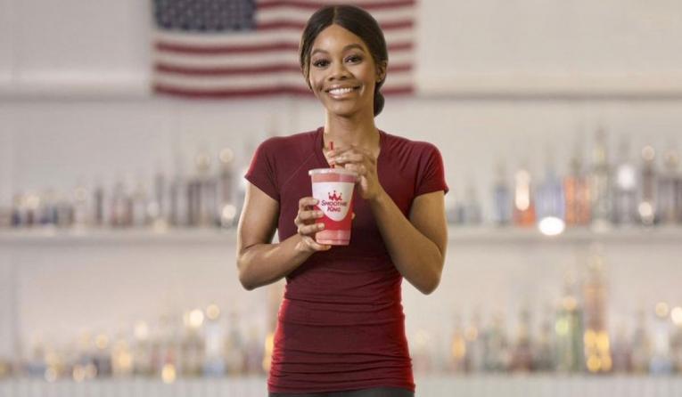 Gabby Douglas holding Smoothie King smoothie