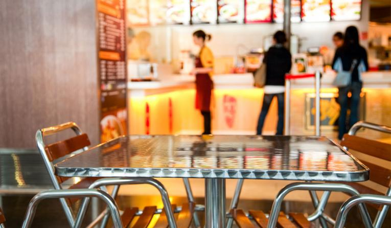 Fast food cafe, with chairs in front.