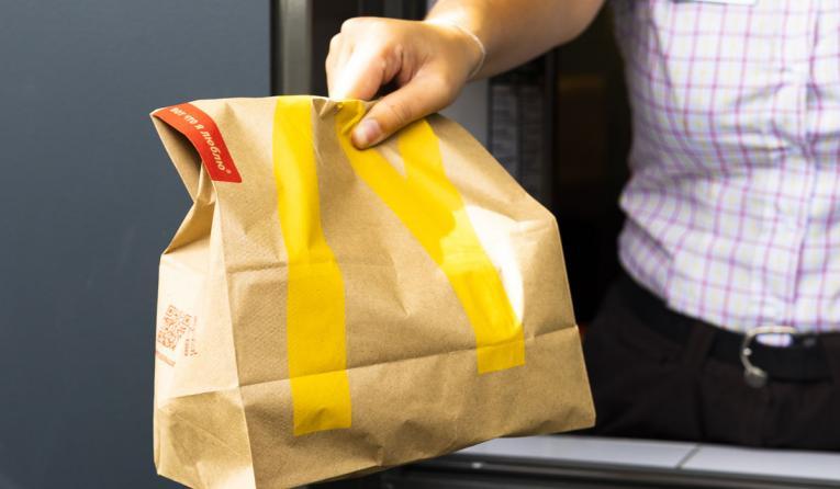 McDonald's bag going out the drive-thru window.