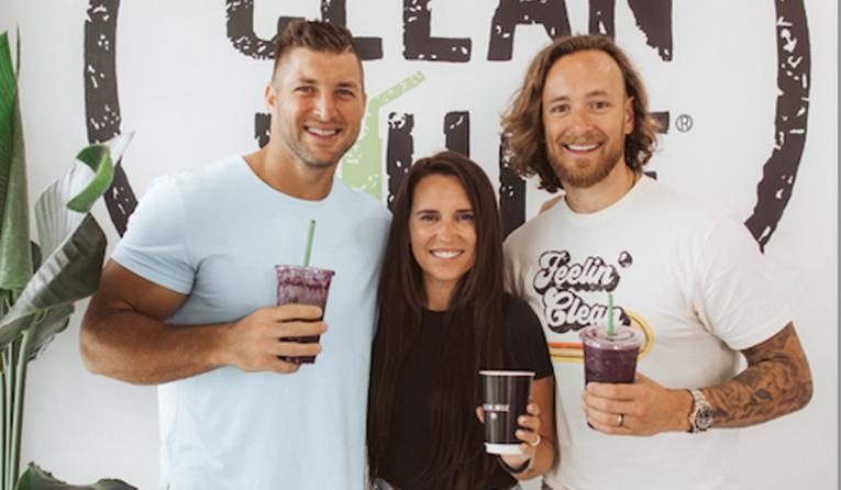 Tim Tebow and Clean Juice owners.
