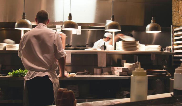 Workers in a restaurant kitchen
