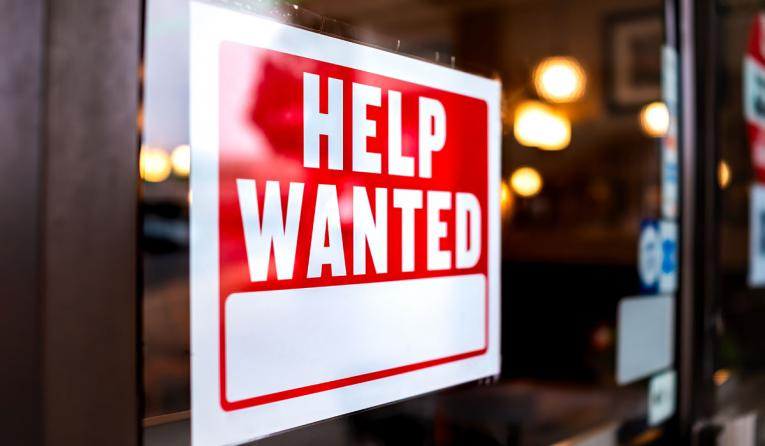 Help wanted sign on window.