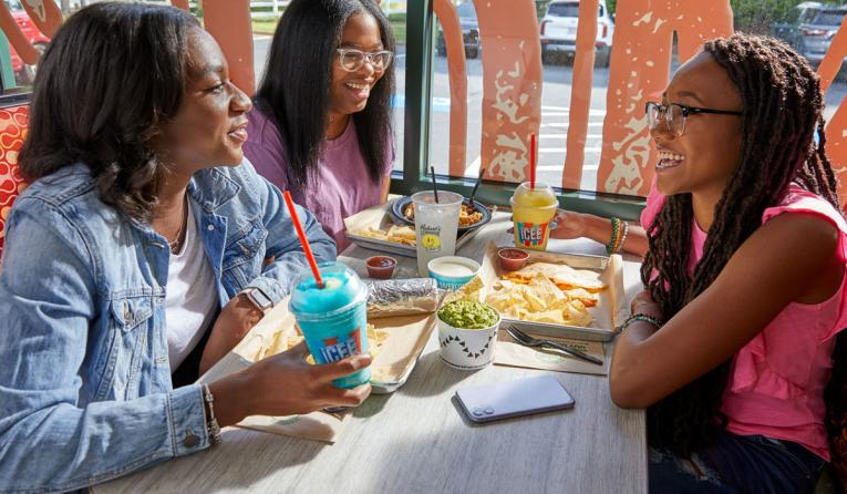 Moe's Southwest Grill customers at a table.