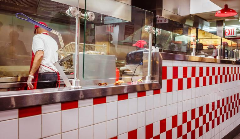 Workers inside a fast-food restaurant.