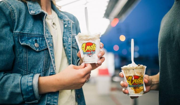 customers holding Andy's Frozen Custard products