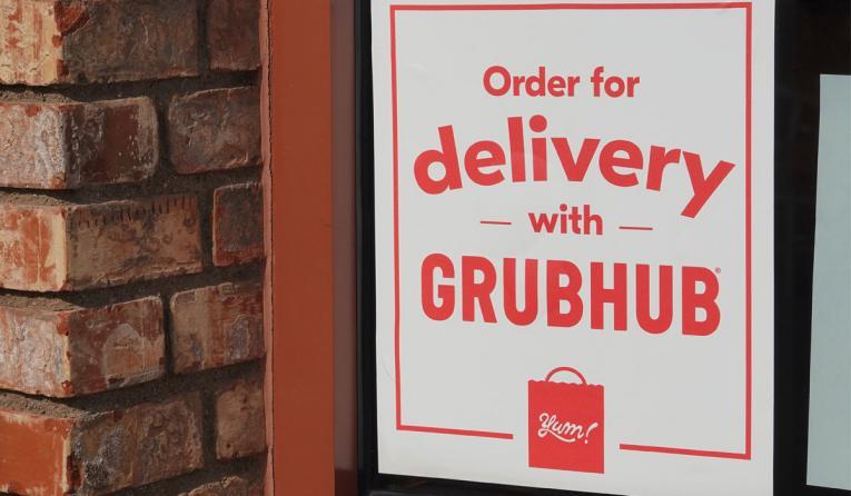 Grubhub sign on a window.