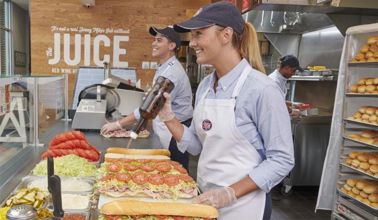 Jersey Mike's employee making a sandwich.