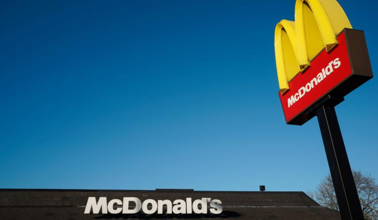 McDonalds logo on blue sky background.