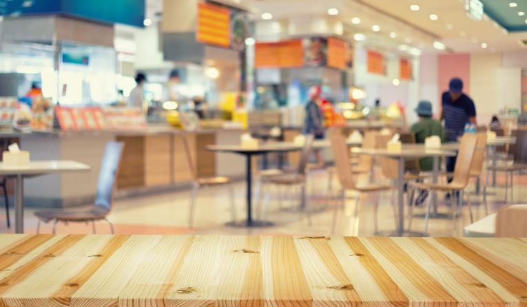 Food court blurred into background.