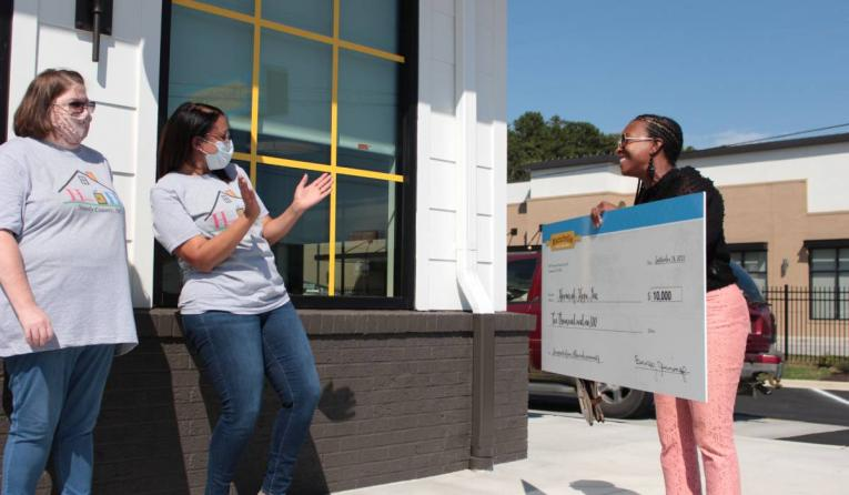 Biscuitville presenting check to Homes of Hope.