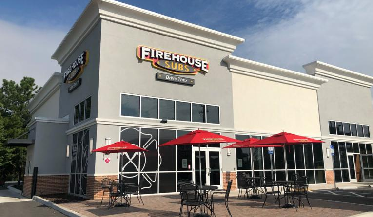 Firehouse Subs exterior of restaurant with drive-thru.