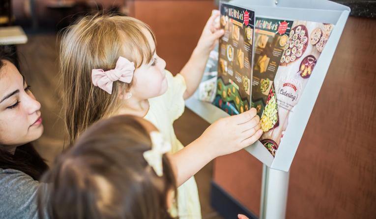 A kid looks at a McAlister's Menu.
