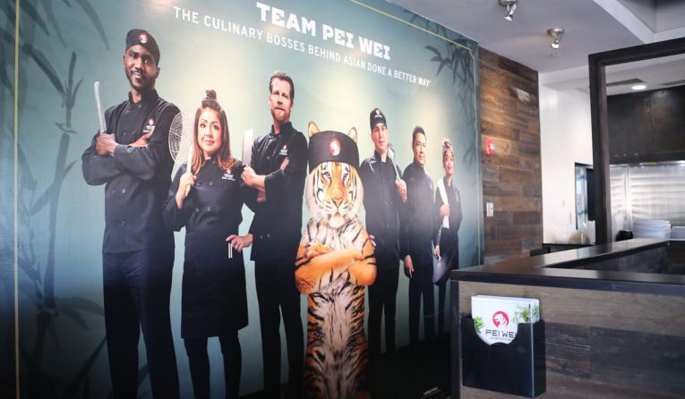 Pei Wei's new mural, complete with chefs and tiger mascot.