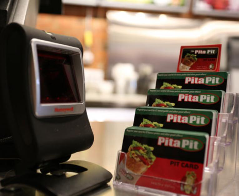 Gift cards stacked up on the counter of Pita Pita, a fast casual restaurant ready to benefit from Trump's tax cuts.