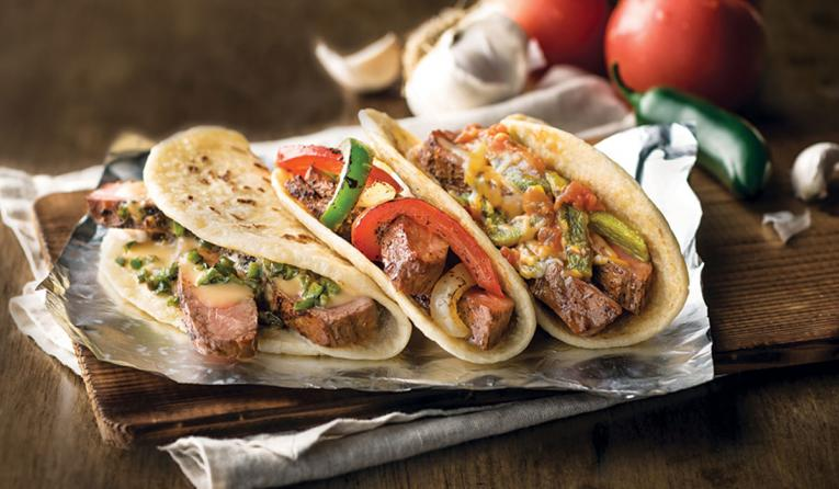 USDA Choice Flame-Grilled Steak Fajitas at Taco Cabana.