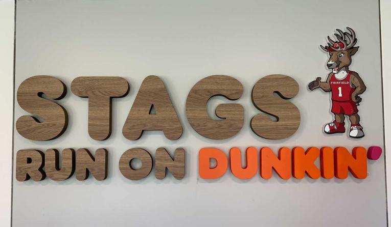 Stag run on Dunkin' sign at Fairfield University