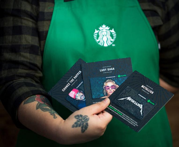 Starbucks is teaming up with Spotify for gift cards.