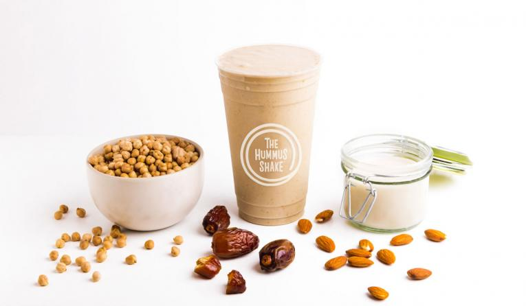 The all-natural Hummus Shake begins with a blended base of real chickpeas, tahini, banana, dates, and almond milk.