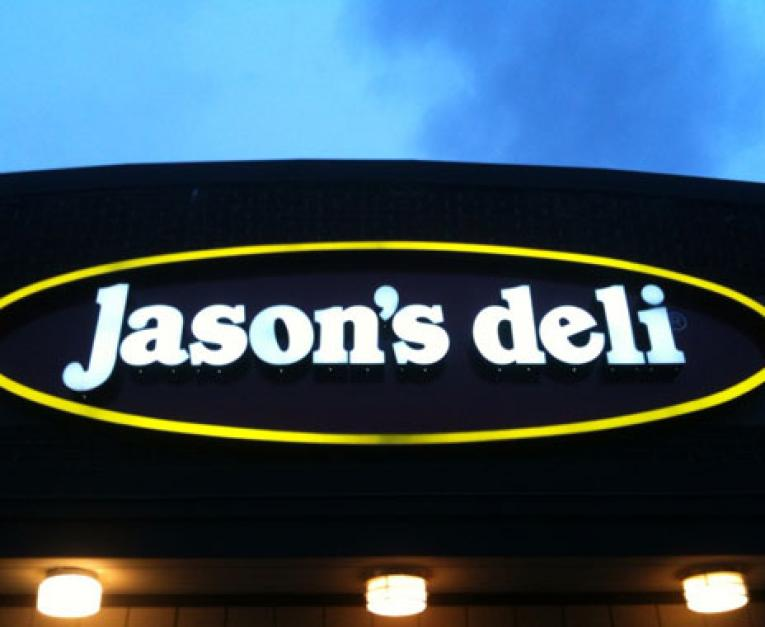 A Jason's Deli sign shines at night. The restaurant is facing a security breach.