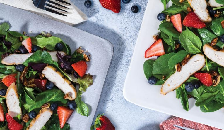 Pecanberry Salad, with fresh strawberries and blueberries, candied pecans and grilled chicken, served with Fat-Free Raspberry-Pecan Vinaigrette dressing.