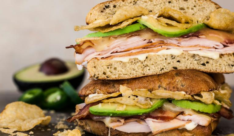 The Jalapeno Turkey Crunch features sliced turkey, bacon, pepper jack cheese, McAlister's Jalapeno Spud Chips, sliced avocado and mayo on a jalapeno roll for a savory and spicy treat with an unexpected crunch.