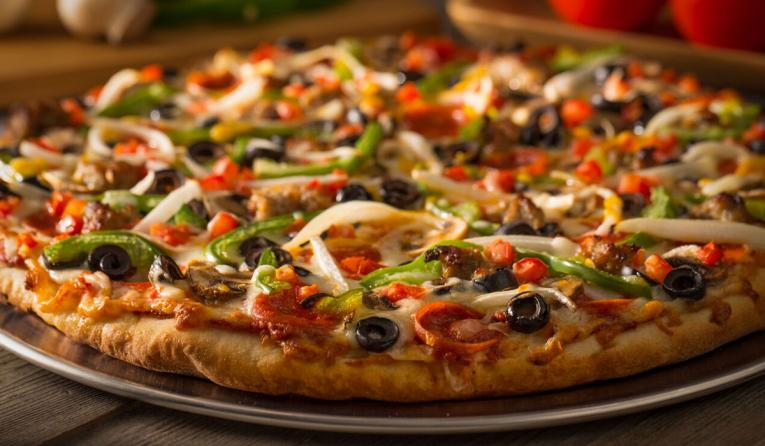 A pizza baked full of vegetables from Mountain Mike's.