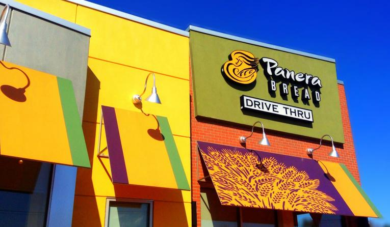 Panera Bread's building, with a drive-thru, is seen outside. The chain is helping other brands clean up their menus.