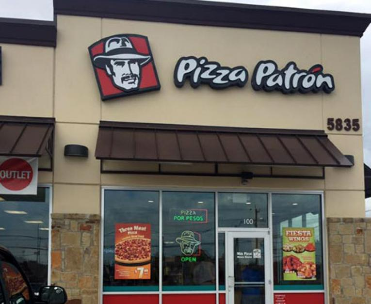 Pizza Patron's restaurant building showcasing its old logo. The brand relaunched with a new one on Monday.