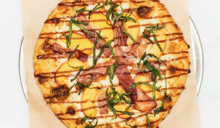 The Peach Prosciutto is made with hand-tossed dough, fresh ingredients and baked to order in a brick oven, per Italian tradition.