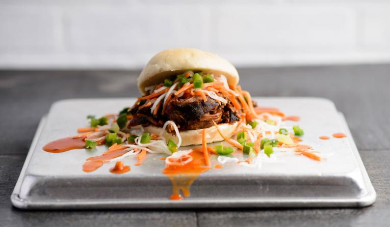 Pork shoulder topped with pickled daikon and carrot, cucumber and jalapeño relish and our Asian Plum Sauce on a steamed bao bun.
