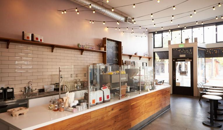 Empty cafe or bar interior, daytime.